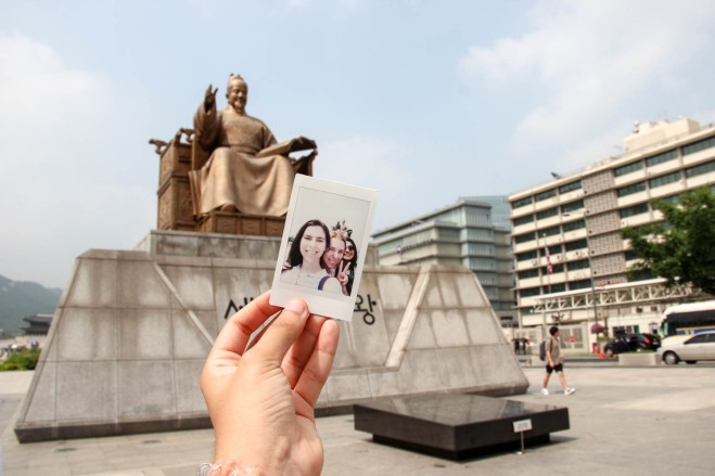 Our Polaroid in front of Kim Sejong the great